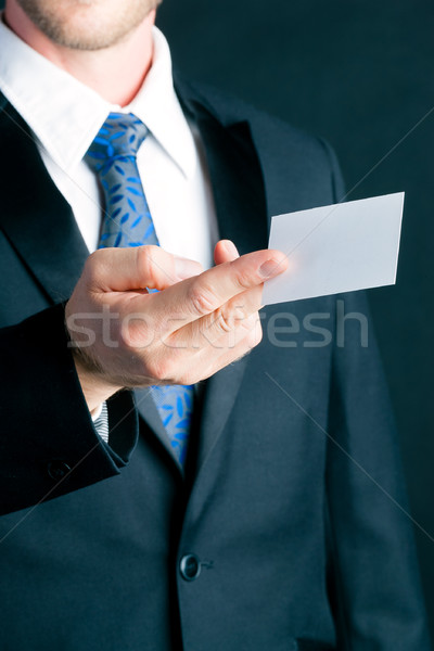 Businessman hand over business card Stock photo © Kzenon