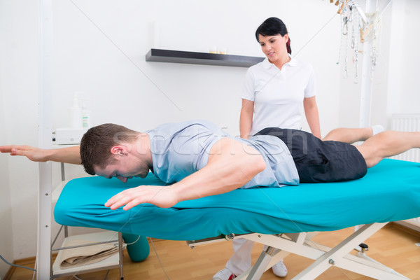 Physiotherapist with patient in practice  Stock photo © Kzenon