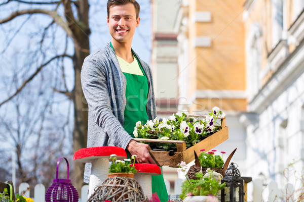 Florist with plant supply at shop Stock photo © Kzenon