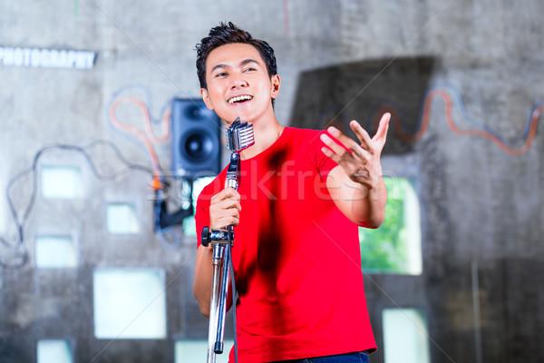 Asian musician producing song in recording studio Stock photo © Kzenon