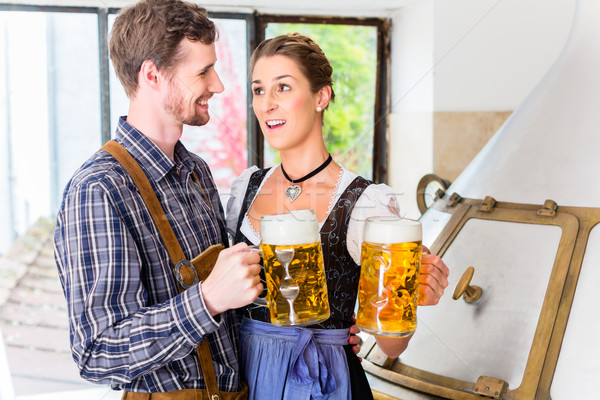 Stock photo: Brewer and woman toasting in beer brewery