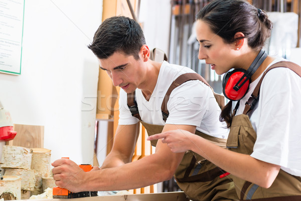 Carpenter team of woman and man working together Stock photo © Kzenon