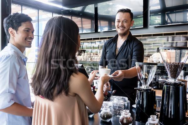 Derűs csapos adag kávézó pult fiatal Stock fotó © Kzenon