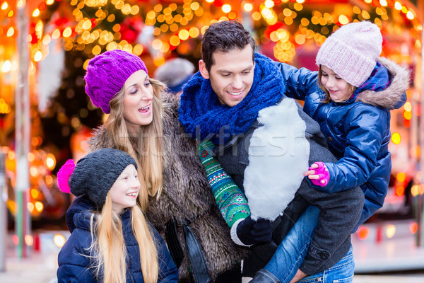 Stock photo: Family eating cotton candy on Christmas market