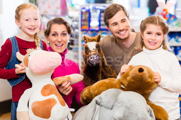 Family with stuffed elephant in toy store playing Stock photo © Kzenon