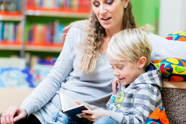 Mom with here little son hitting the library the first time Stock photo © Kzenon