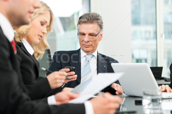 Stock photo: Business people - team meeting in an office