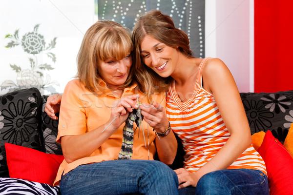Woman teaching her daughter knitting Stock photo © Kzenon