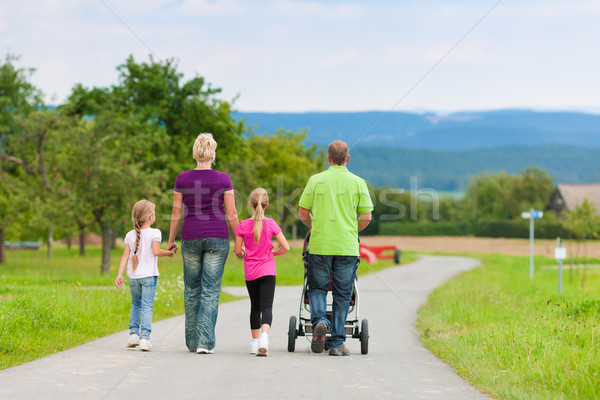 Family with children having walk Stock photo © Kzenon