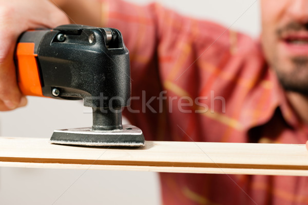 Man is grinding a plank Stock photo © Kzenon