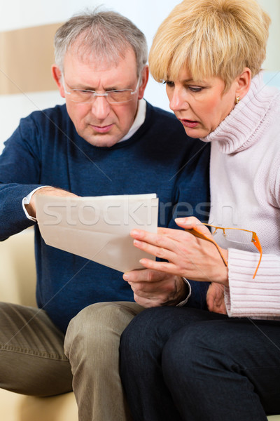Seniors at home receiving a bad message Stock photo © Kzenon