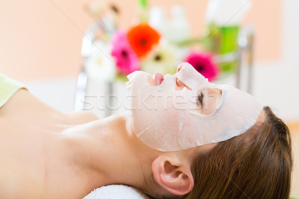 Wellness - woman getting face mask in spa Stock photo © Kzenon