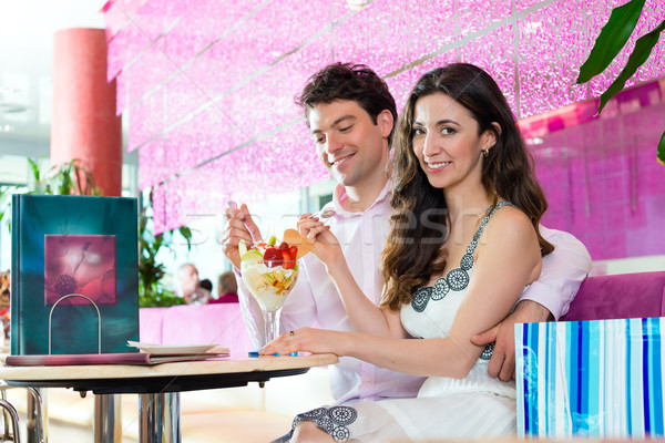 Young couple enjoying time in ice cream parlor Stock photo © Kzenon