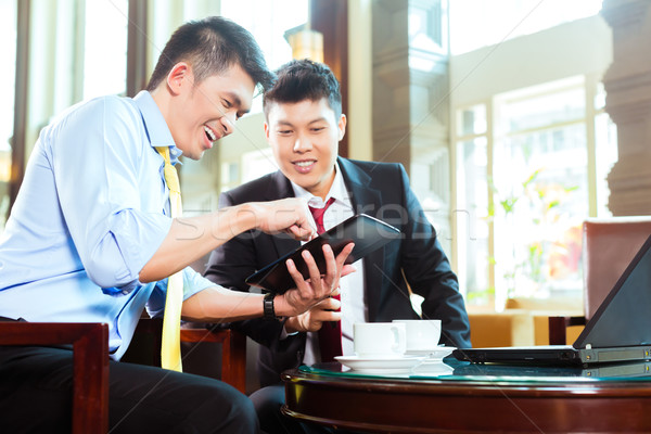Chinese businessmen at business meeting in hotel Stock photo © Kzenon