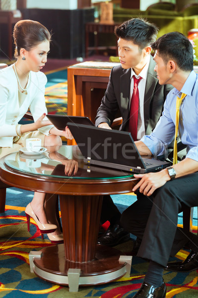 Chinese business people at meeting in hotel lobby Stock photo © Kzenon