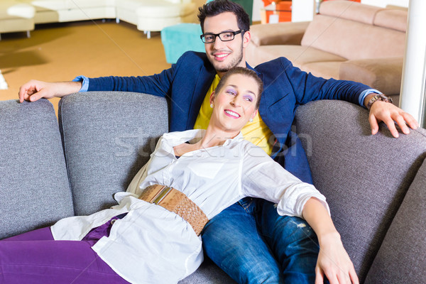 Couple buying couch in furniture store Stock photo © Kzenon