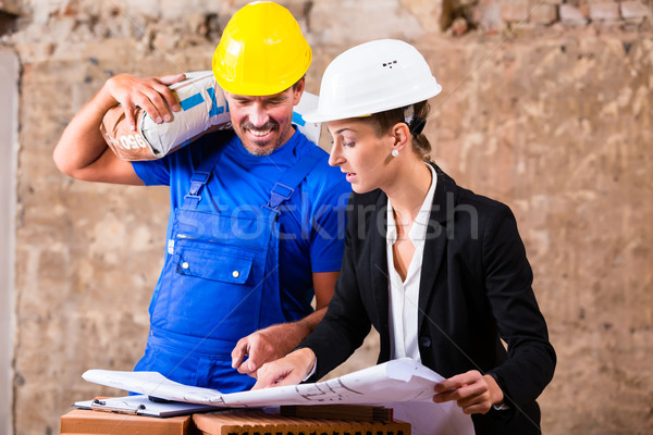 Architect and construction worker on site with plan Stock photo © Kzenon