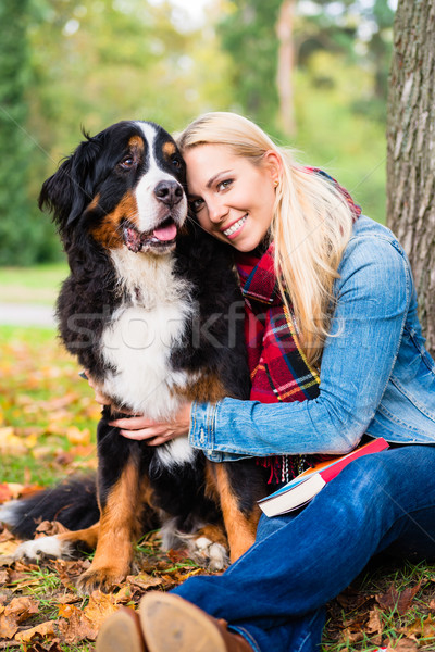 Woman cuddling with dog outside in park Stock photo © Kzenon