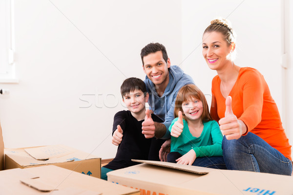Family moving in new home or house Stock photo © Kzenon