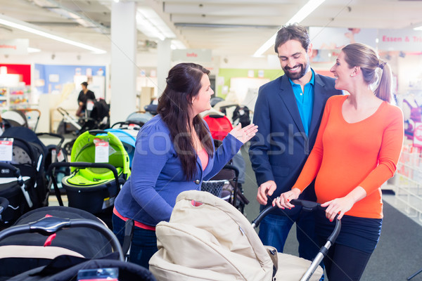 Woman, man, and sales lady in baby store Stock photo © Kzenon