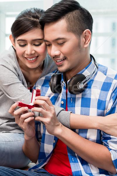 Young Indonesian man makes proposal to girlfriend  Stock photo © Kzenon