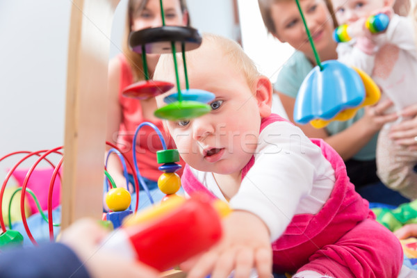 Cute baby girl showing progress and curiosity Stock photo © Kzenon