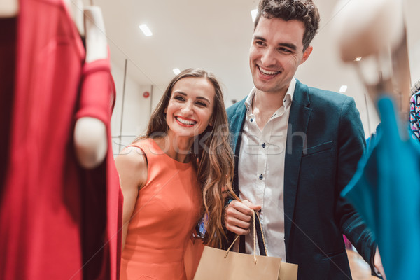 Couple craving for new clothes in fashion shopping spree Stock photo © Kzenon