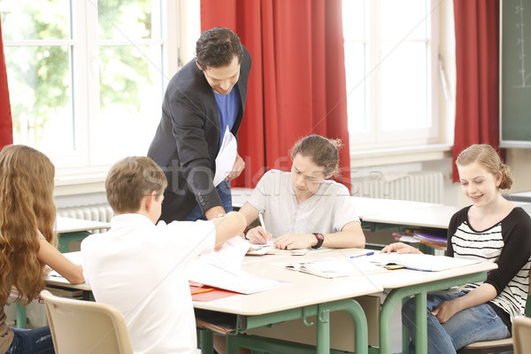Teacher teaching or educate at the board a class in school Stock photo © Kzenon