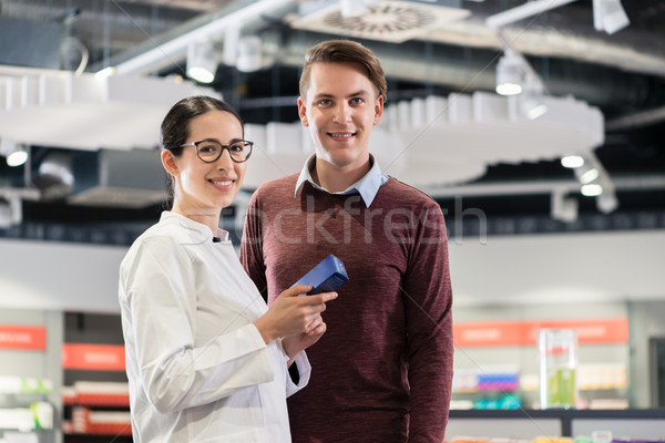 Portrait of a customer standing next to a reliable pharmacist Stock photo © Kzenon