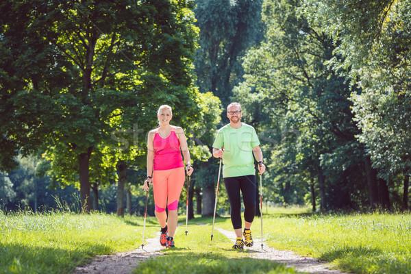 Pár északi sétál sport férfi nő Stock fotó © Kzenon