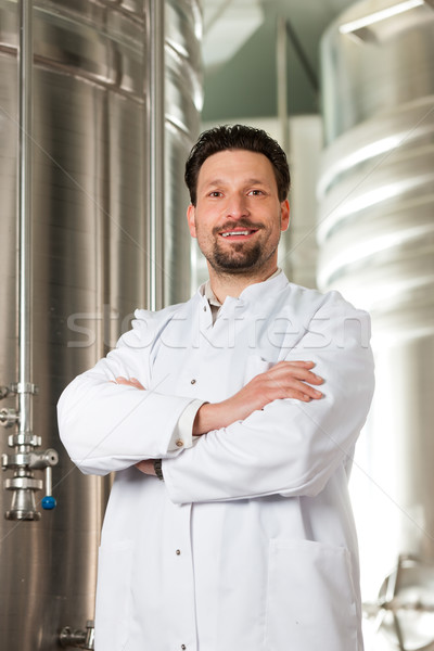 Beer brewer in his brewery Stock photo © Kzenon