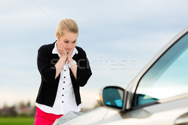 Young woman with map on car being lost Stock photo © Kzenon