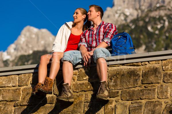 Happy Couple hiking in alp mountains Stock photo © Kzenon