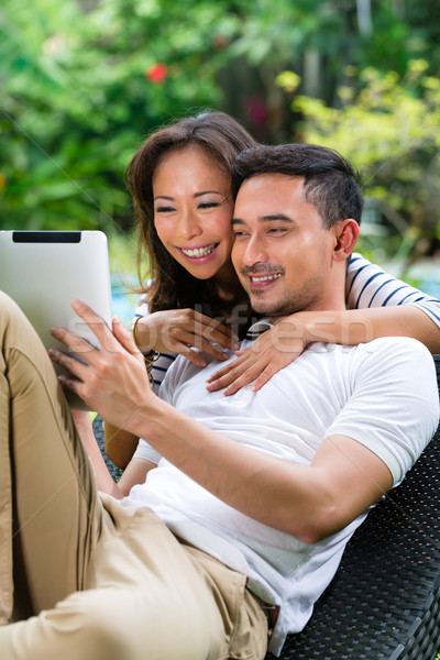 Asian couple outdoor with a tablet pc Stock photo © Kzenon