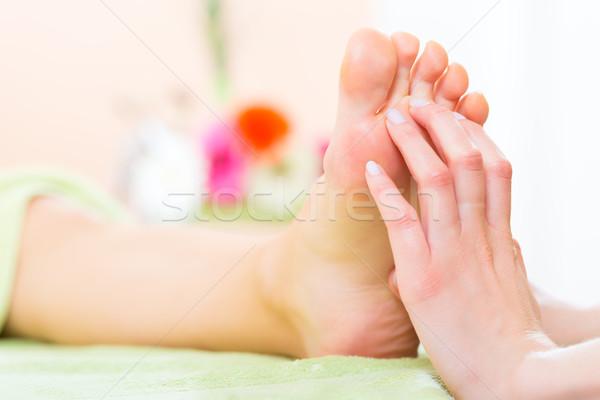 Nő manikűrös láb masszázs pedikűr virágok Stock fotó © Kzenon