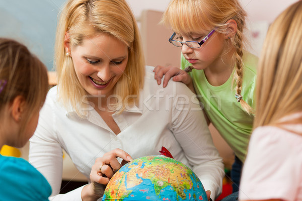 Mother explaining the world to her children Stock photo © Kzenon