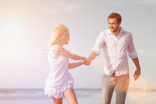 Couple on beach in honeymoon vacation Stock photo © Kzenon