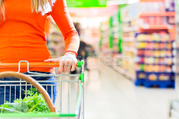 Woman with shopping cart in supermarket Stock photo © Kzenon