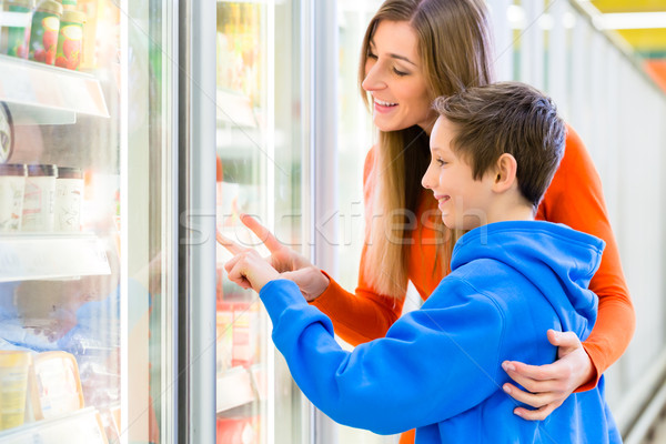 Family selecting cooled products in hypermarket Stock photo © Kzenon