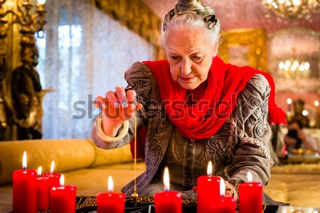 Soothsayer with crystal ball and client Stock photo © Kzenon