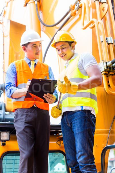 Asian mechanic with construction machine Stock photo © Kzenon