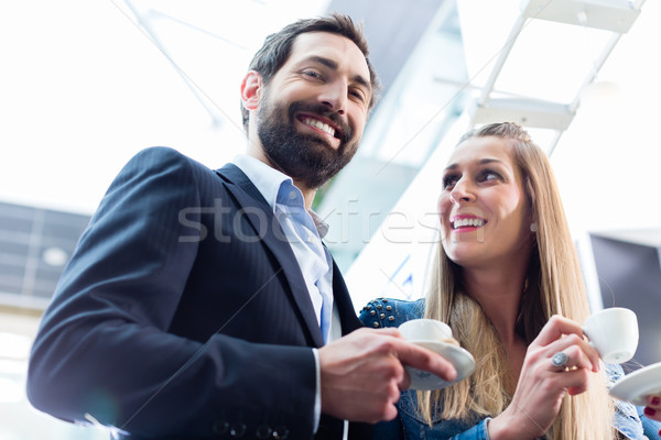 Man flirting with woman while drinking coffee Stock photo © Kzenon