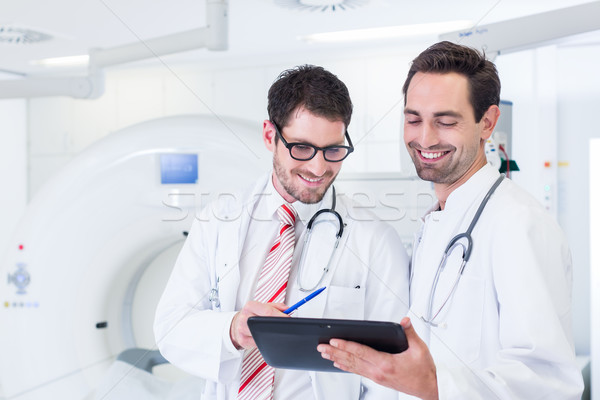 Doctors discussing images of x-ray scan in CT Stock photo © Kzenon