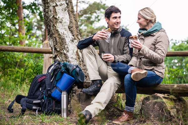 Couple on hike taking rest under tree  Stock photo © Kzenon