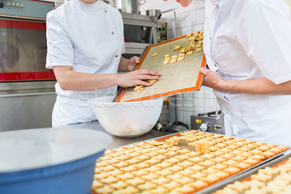 Cookies being baked in pastry bakery Stock photo © Kzenon