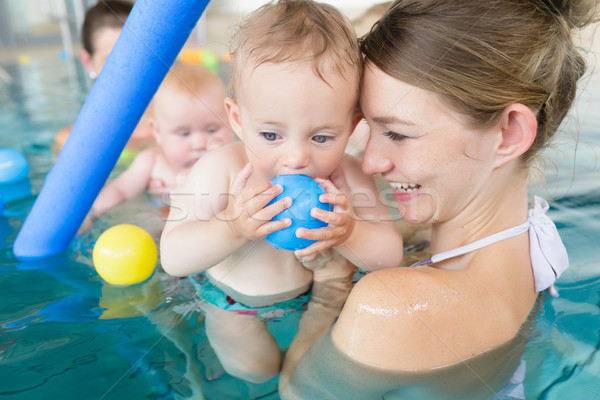 Mums and babies having fun at infant swimming course  Stock photo © Kzenon