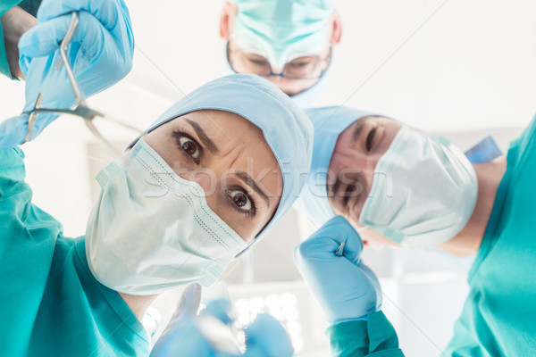 Mad surgeon doctors looking at patient POV Stock photo © Kzenon