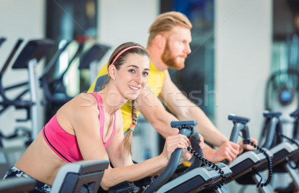 Stock photo: Portrait of a beautiful woman during cardio routine on stationary bicycle