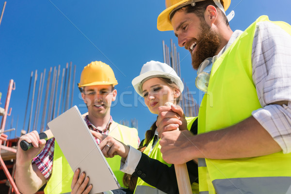 Architect or manager showing to her colleagues electronic building plan Stock photo © Kzenon
