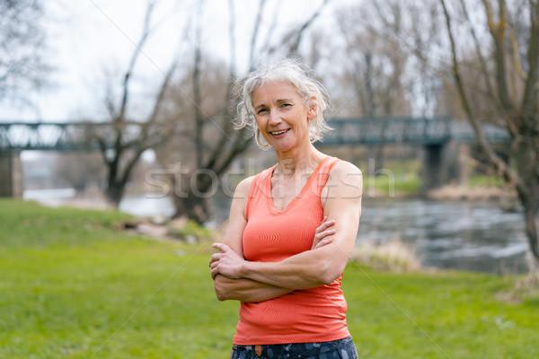 Senior woman in sport clothes looking at camera Stock photo © Kzenon